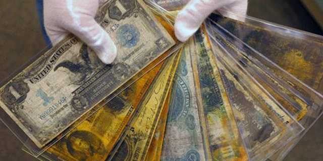 Aug 15, 2008: Currency, part of the artifacts collection of the Titanic, is shown at a warehouse in Atlanta.