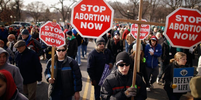 WASHINGTON, DC - JANUARY 24: Tens of thousands of anti-abortion demonstrators march along Constitution Avenue toward the Supreme Court during the March for Life January 24, 2011 in Washington, DC. (Photo by Chip Somodevilla/Getty Images)