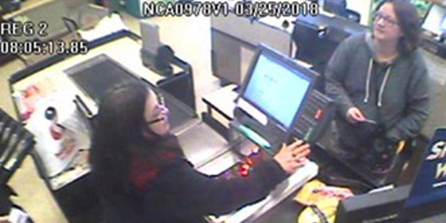 This March 25, 2018, Safeway surveillance photo provided by the California Highway Patrol shows Jennifer Hart, right, at a Safeway store in Fort Bragg, Calif.