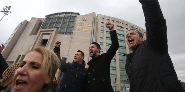 Supporters of the main opposition Republican People's Party, or CHP, chant slogans during a protest outside Istanbul's Court House, Tuesday, April 18, 2017. Hundreds of people are queuing in front of Turkey's election board to submit petitions requesting that the electoral authority reverse a controversial decision during Sunday's referendum to accept ballots without official stamps. (AP Photo/Petros Karadjias)