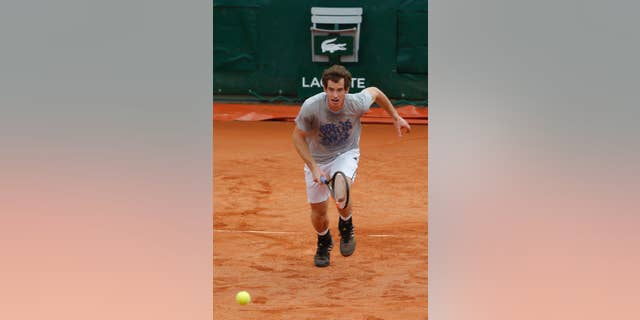 Britain's Andy Murray runs for the ball during a training session for the French Open tennis tournament, at the Roland Garros stadium in Paris, Friday, May 23, 2014. The French Open tennis tournament starts Sunday. (AP Photo/Michel Euler)