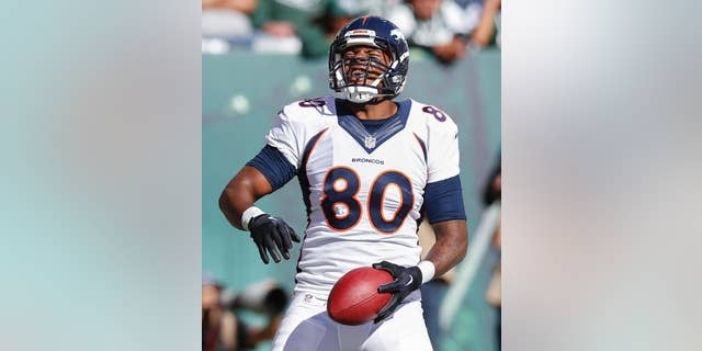 Denver Broncos tight end Julius Thomas (80) reacts after scoring a touchdown against the New York Jets during the third quarter of an NFL football game, Sunday, Oct. 12, 2014, in East Rutherford, N.J. (AP Photo/Kathy Willens)