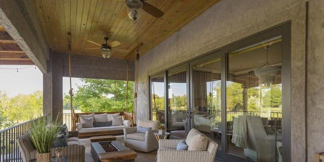 """The design of the home is traditional but relaxed where it matters, such as on the porch, complete with a swing for two and tailor-made for enjoying an """"Amarillo Sky."""""""