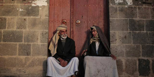 Yemeni men chat while sitting in front of their house in the old city of Sanaa, Yemen, Saturday, Nov. 19, 2016. (AP Photo/Hani Mohammed)