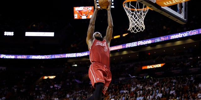 Miami Heat's LeBron James (6) shoots during the first half of an NBA basketball game against the Phoenix Suns, Monday, Nov. 25, 2013, in Miami. (AP Photo/Lynne Sladky)