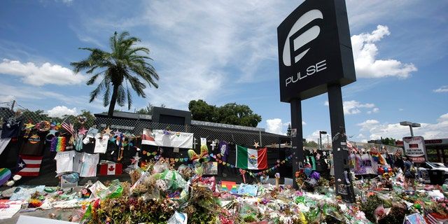 In this July 11, 2016, file photo, a makeshift memorial continues to grow outside the Pulse nightclub, the day before the one month anniversary of a mass shooting, in Orlando, Fla.