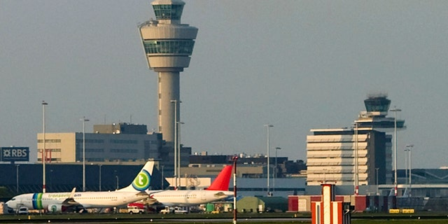 Two men from the Detroit area suspected of terrorist activity were arrested at Amsterdam's airport, shown in this April 2010 file photo.