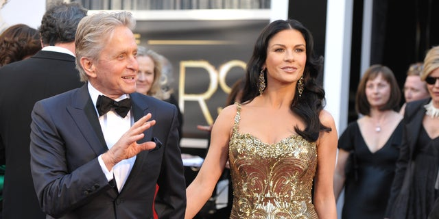 Actors Michael Douglas, left, and Catherine Zeta-Jones arrives at the Oscars at the Dolby Theatre on Sunday Feb. 24, 2013, in Los Angeles.