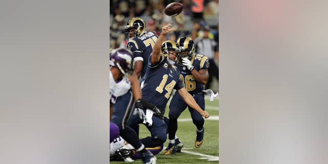 St. Louis Rams quarterback Shaun Hill gets off a pass while falling for a 4-yard gain to Rams tight end Jared Cook during the first quarter an NFL football game against the Minnesota Vikings Sunday, Sept. 7, 2014, in St. Louis. (AP Photo/Tom Gannam)