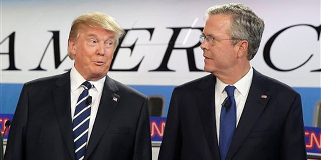 Republican presidential candidates, businessman Donald Trump, left, and former Florida Gov. Jeb Bush talk together before the start of the CNN Republican presidential debate at the Ronald Reagan Presidential Library and Museum on Wednesday, Sept. 16, 2015, in Simi Valley, Calif. (AP Photo/Chris Carlson)