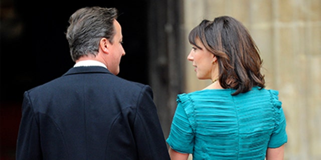 Britain's Prime Minister David Cameron arrives with his wife Samantha at Westminster Abbey before the wedding of Britain's Prince William and Kate Middleton, in central London April 29, 2011.