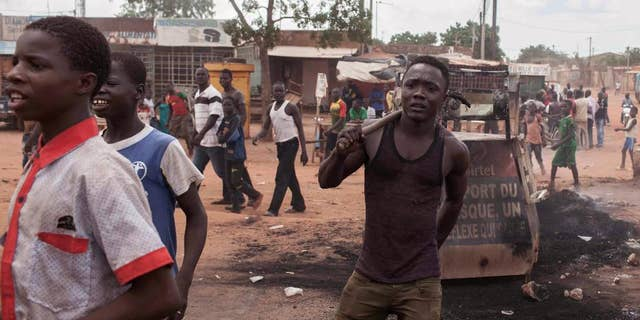 Protestors in the city of Ouagadougou, Burkina Faso, Thursday, Sept. 17, 2015. While gunfire rang out in the streets, Burkina Faso's military took to the airwaves Thursday to declare it now controls the West African country, confirming that a coup had taken place just weeks before elections. (AP Photo/Theo Renaut)