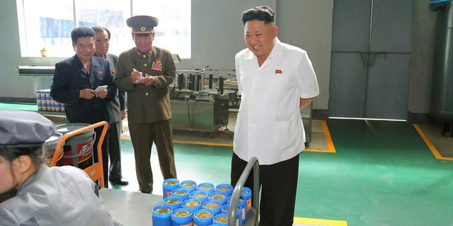 Kim Jong Un smiles during a visit to the Chonji Lubricant Factory.
