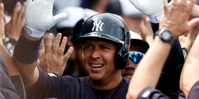 Mar 3, 2016; Tampa, FL, USA; Alex Rodriguez celebrates with high fives as he walks through the dugout after hitting a two run home run against the Philadelphia Phillies (Butch Dill-USA TODAY Sports)