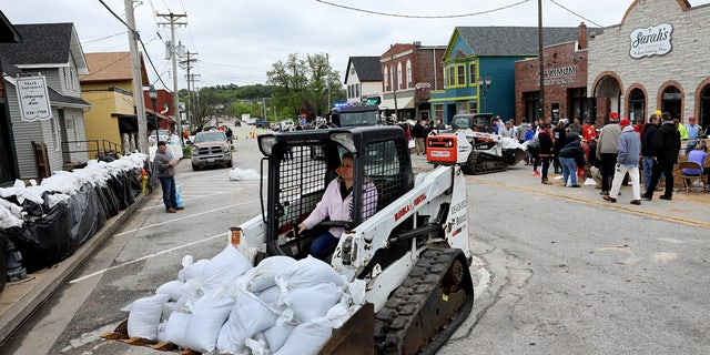 Sandbags are being used to protect the suburban town of Eureka from the Meramec River's rising floodwaters.