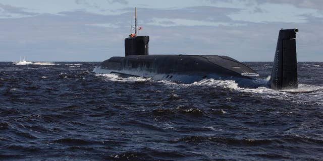FILE - in this file photo taken on Thursday, July 2, 2009, the Russian nuclear submarine, Yuri Dolgoruky, is seen during sea trials near Arkhangelsk, Russia. The Russian navy said in a statement Friday March 31, 2017, that its submarines have increased combat patrols to the level last seen during the Cold War. (AP Photo/Alexander Zemlianichenko, File)