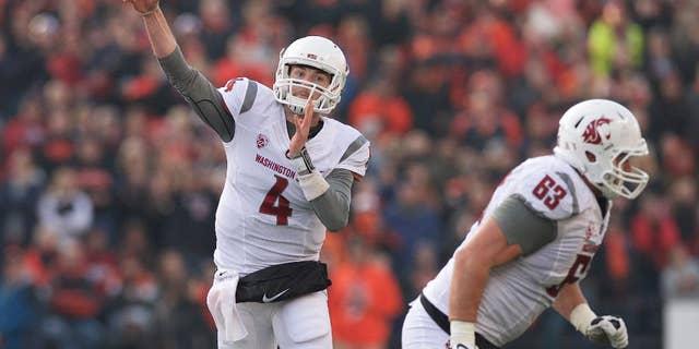 Washington State quarterback Luke Falk (4) throws a pass during an NCAA college football game against Oregon State in Corvallis, Ore., Saturday, Nov. 8, 2014. The Cougars beat the Beavers 39-32. (AP Photo/Troy Wayrynen)