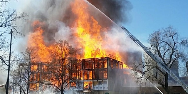Flames and smoke from a Wednesday blaze in Denver rose up to 200 feet, officials said.