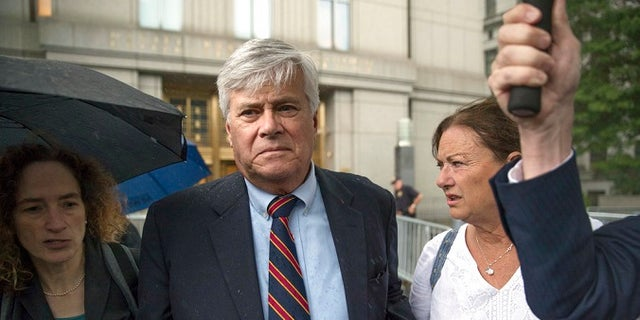 Dean Skelos, center, leaves federal court, Tuesday, July 17, 2018, in New York City. The former New York state Senate leader and his son Adam were convicted on Tuesday of extortion, wire fraud and bribery charges of pressuring businesses to give the son no-show jobs or else risk losing the powerful Republican's political support.