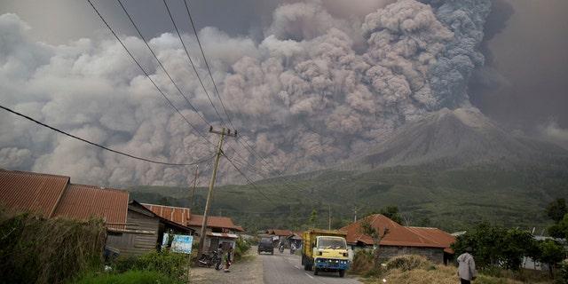 Mount Sinabung spews volcanic ash as it erupts in Kutarakyat, North Sumatra, Indonesia, Monday, Feb. 19, 2018.
