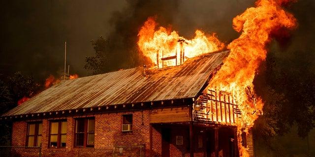A historic schoolhouse burns as the Carr Fire tears through Shasta, Calif., July 26, 2018.