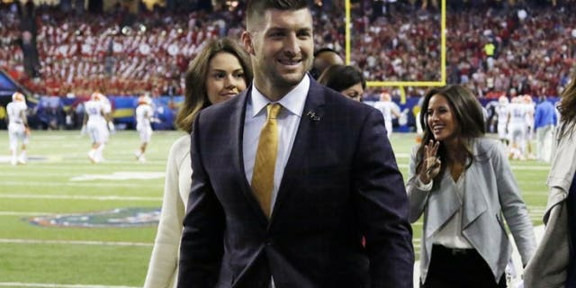 Dec 5, 2015; Atlanta, GA, USA; Florida Gators former quarterback Tim Tebow on the sideline during the game against the Alabama Crimson Tide in the 2015 SEC Championship Game at the Georgia Dome. Mandatory Credit: Brett Davis-USA TODAY Sports