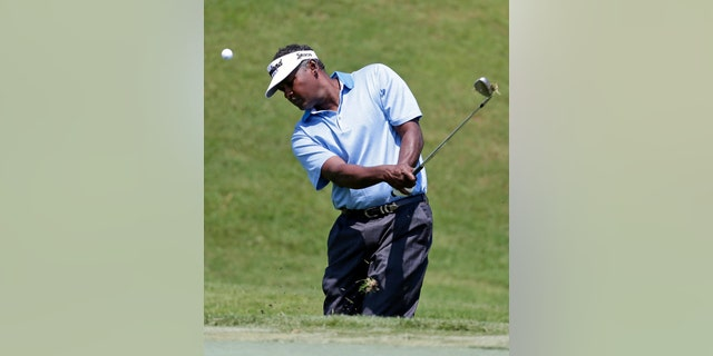 Vijay Singh, from Fiji, chips onto the second green during the first round of The Players championship golf tournament at TPC Sawgrass, Thursday, May 9, 2013, in Ponte Vedra Beach, Fla. (AP Photo/Chris O'Meara)
