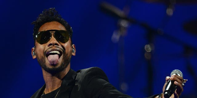 LAS VEGAS, NV - SEPTEMBER 21:  Singer Miguel performs during the iHeartRadio Music Festival at the MGM Grand Garden Arena on September 21, 2013 in Las Vegas, Nevada.  (Photo by Ethan Miller/Getty Images for Clear Channel)