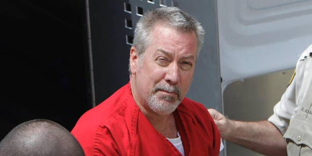 In this May 8, 2009 file photo, former Bolingbrook, Ill., police officer Drew Peterson arrives for court in Joliet, Ill. AP Photo/M. Spencer Green