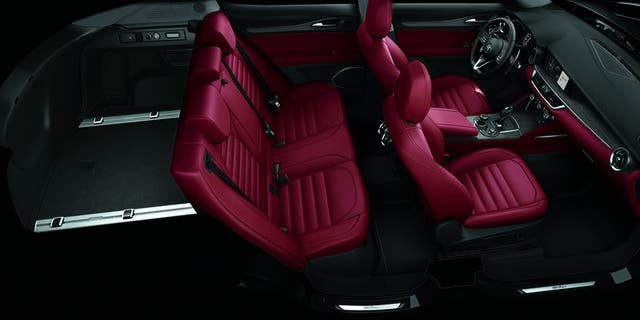 The Stelvio's cabin is sports car cool.