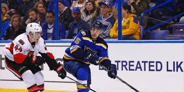 FILE - In this Jan. 17, 2017, file photo, St. Louis Blues' Robby Fabbri, right, looks to pass the puck as he is pressured by Ottawa Senators' Jean-Gabriel Pageau during the second period of an NHL hockey game in St. Louis. On Sunday, Feb. 5, 2017, the Blues announced Fabbri is out with an ACL injury for the rest of the season. (AP Photo/Billy Hurst, File)