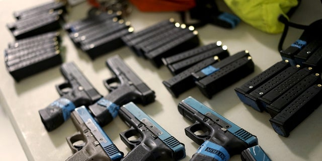 Some Glock semi-automatic pistols and non-lethal training ammunition are seen in Denver, April 2, 2016.