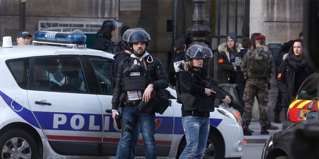Feb.3 Police officers guard the access to the Louvre museum