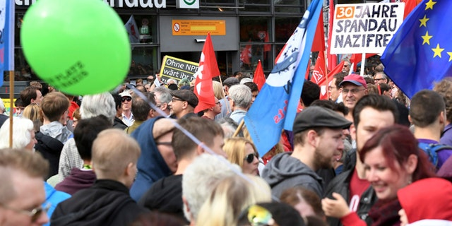 A counter demonstration marches in Berlin after police gave far-right extremists permission to hold a 500-person rally marking the death of Adolph Hitler's deputy.