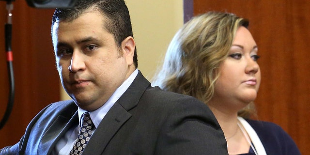 SANFORD, FL - JUNE 24: George Zimmerman arrives with his wife Shellie, on the 11th day of his trial in Seminole circuit court June 24, 2013 in Sanford, Florida. Today prosecutors began with their opening statements. Zimmerman is charged with second-degree murder for the February 2012 shooting death of 17-year-old Trayvon Martin.  (Photo by Joe Burbank-Pool/Getty Images)