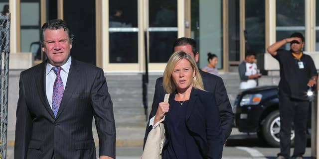 New Jersey Gov. Chris Christie's former Deputy Chief of Staff Bridget Anne Kelly, right, was sentenced to over a year behind bars.