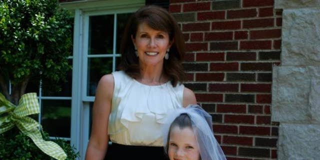 In this undated photo obtained by Fox affiliate KTVI, Cathy Murch is seen with her daughter. Murch and her two children were found dead inside their suburban St. Louis home Monday in what police suspect was a murder-suicide.