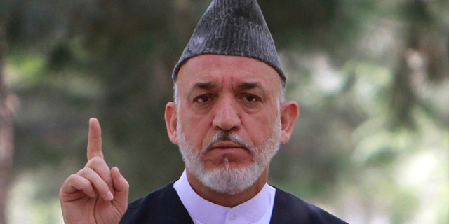 Afghan President Hamid Karzai speaks during a gathering with high ranking Afghan military officials at the presidential palace in Kabul, Afghanistan on Tuesday, July 26, 2011. Afghanistan's president has told his country's soldiers and police that they face a difficult year ahead as they take on more security responsibilities, but he wants them to push ahead so that Afghanistan can eventually defend itself. (AP Photo/Musadeq Sadeq)