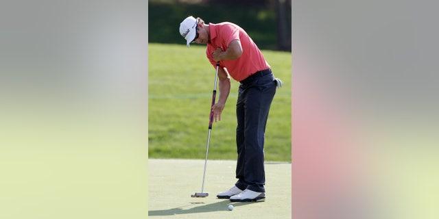 Adam Scott, of Australia, putts during the pro-am of the Memorial golf tournament Wednesday, May 29, 2013, in Dublin, Ohio. (AP Photo/Jay LaPrete)