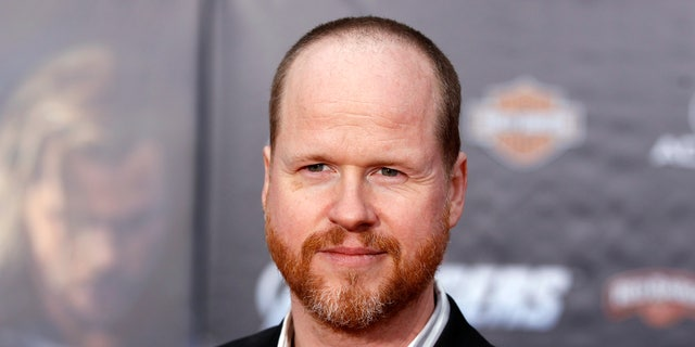"""Director Joss Whedon poses at the world premiere of the film """"Marvel's The Avengers"""" in Hollywood, California April 11, 2012."""