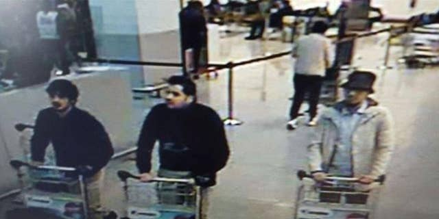 A surveillance image taken at the Zaventem airport before the attack. The men believed to be the suicide bombers, on the left, wore gloves on their left hands.