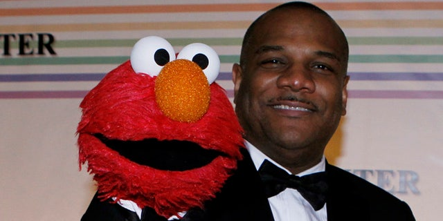 Kevin Clash (right) and Elmo.