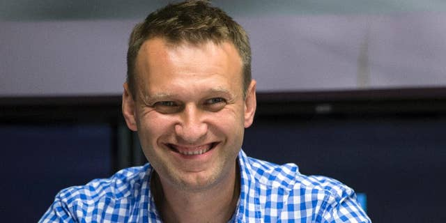 FILE - In this file photo taken on Wednesday, July 29, 2015, Russian opposition activist Alexei Navalny smiles before a broadcast at the Echo Moskvy (Echo of Moscow) radio station in Moscow. Russia's Supreme Court has sent a criminal case of the opposition leader for retrial following a ruling of the European Court of Human Rights. (AP Photo/Pavel Golovkin, FILE)