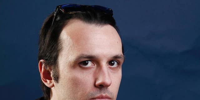 """In this Jan. 22, 2012, file photo, documentary subject Damien Echols, from the film """"West of Memphis,"""" poses for a portrait in Park City, Utah. Echols spent nearly 18 years on Arkansas' death row before he and two others were freed in 2011 as part of a plea deal. (AP Photo/Carlo Allegri, File)"""