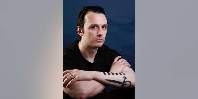 "In this Jan. 22, 2012, file photo, documentary subject Damien Echols, from the film ""West of Memphis,"" poses for a portrait in Park City, Utah. Echols spent nearly 18 years on Arkansas' death row before he and two others were freed in 2011 as part of a plea deal. (AP Photo/Carlo Allegri, File)"