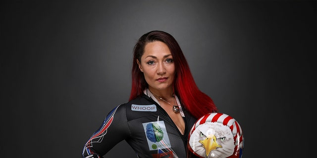 Katie Uhlaender will return to the Games with her signature fiery fuschia tresses.