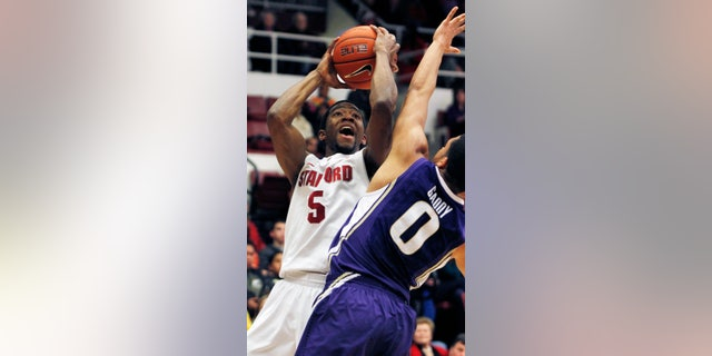 Stanford's Chasson Randle shoots over Washington's Abdul Gaddy during the first half of an NCAA college basketball game, Saturday, Jan. 12, 2013 in Berkeley, Calif. (AP Photo/George Nikitin)