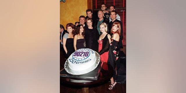 The cast of the popular television series 'Beverly Hills 90210' pose together at a party celebrating the program's 250th episode on November 4 in Los Angeles, Calif. Shown are cast members (L-R, bottom to top) Tiffani-Amber Thiessen, Vanessa Marcil, Gabrielle Carteras, Jennie Garth, Tori Spelling, Joe E. Tata, Vincent Young, Ian Ziering, Daniel Cosgrove, Brian Austin Green and Luke Perry.