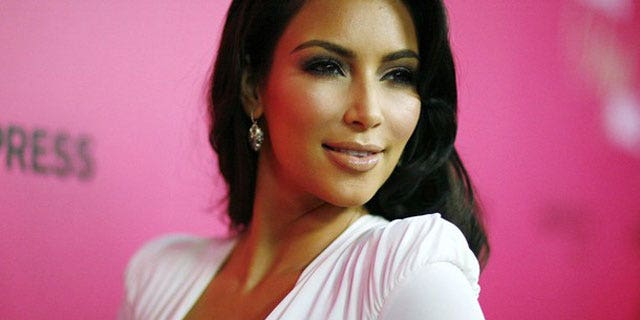 Reality star Kim Kardashian begged a fan via Twitter not to go under the knife to look like her.