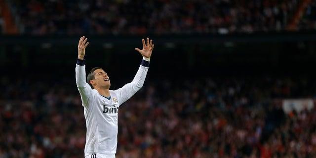 Real Madrid's Cristiano Ronaldo reacts during the Copa del Rey final soccer match between Atletico de Madrid and Real Madrid at the Santiago Bernabeu stadium in Madrid, Spain, Friday, May 17, 2013. (AP Photo/Daniel Ochoa de Olza)